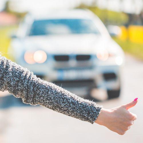 blonde-woman-hitchhiking